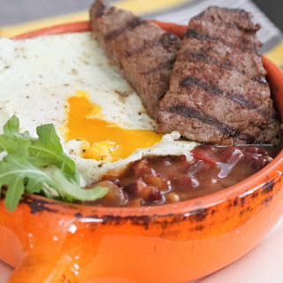 Grilled Breakfast Steak Over Fried Egg and Beans.