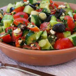 Chopped Tomato and Cucumber Salad Recipe with Mint, Feta, Lemon, and Thyme.