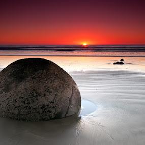 Moeraki Sunstar by Jay Gould - Landscapes Sunsets & Sunrises ( water, south island, 2011, beach, sunrise, orange sky, moeraki boulders, new zealand,  )