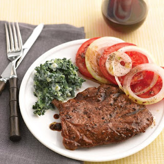 Seared Steaks with Tomato Salad and Creamy Spinach.