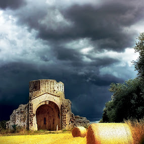 EARTHLY CONTRAST by Paolo Lazzarotti - Landscapes Prairies, Meadows & Fields ( contrast, tuscany, old church, summer, bales, ruins, storm, heavy clouds )