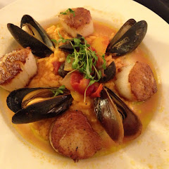 Pan-seared Sea Scallops with tomato risotto, escargot, & mussels. Yummy!