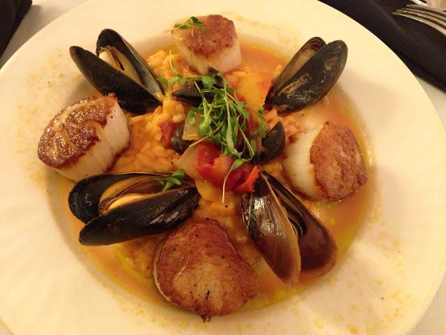 Pan-seared Sea Scallops with tomato risotto, escargot, & mussels. Yummy!