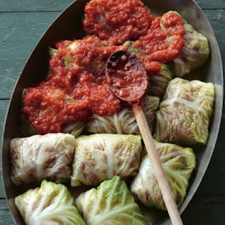 Stuffed Savoy Cabbage with Beef, Pork, and Rice in a Spicy Tomato Sauce.