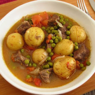 Stewed Meat With Potatoes And Peas