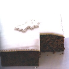 Decorating the Prune and Armagnac Creole Cake