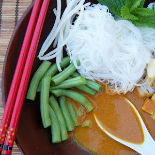 Spicy Coconut Curry with Green Beans, Fried Tofu, and Bean Sprouts.