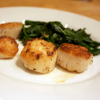 Seared Scallops with Spinach and Arugula.