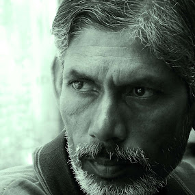 The Hawker by Udaybhanu Sarkar - People Portraits of Men ( beared, green, close up, portrait, man )