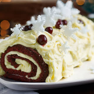 Red velvet bûche de Noël with boozy cranberries.