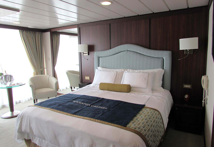The bedroom of the Vista Suite aboard Oceania Regatta.