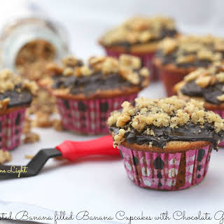 Roasted Banana Filled Banana Cupcakes with Chocolate Ganache.