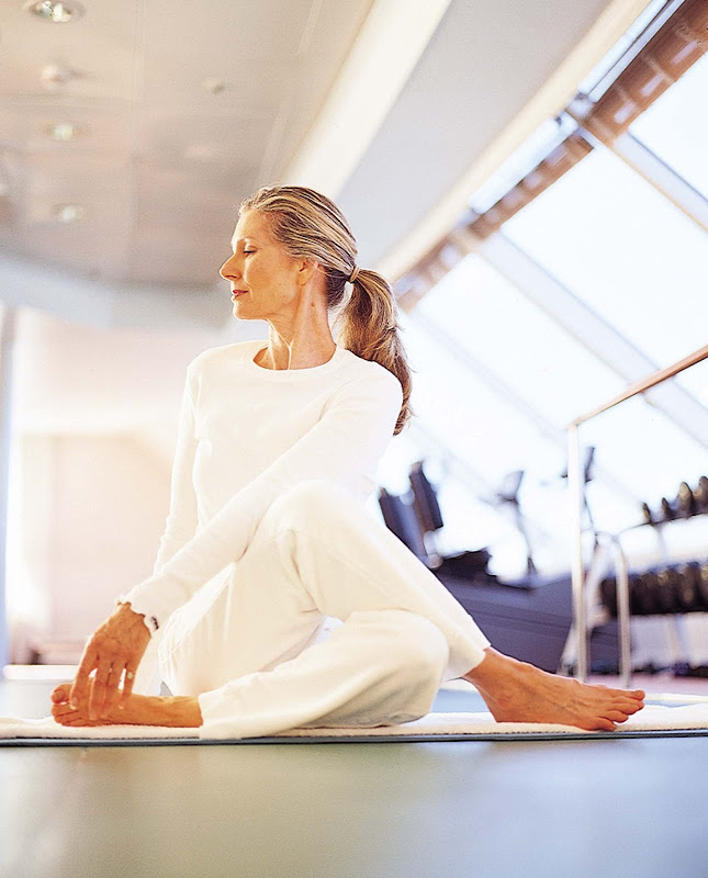 Expert yoga instructors guide guests through relaxing poses on Crystal cruises.