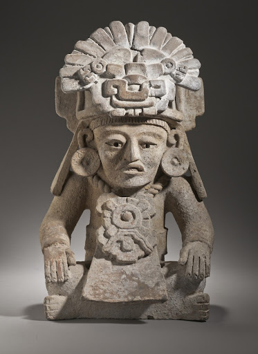 Seated Male Figure with Glyph C Headdress