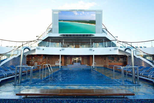 Carnival-Liberty-Seaside-Theatre - Settle into a hot tub or deck chair and watch movies, live sporting events and other entertainment on Seaside Theatre's jumbo screen, at the Tivoli pool on Carnival Liberty.