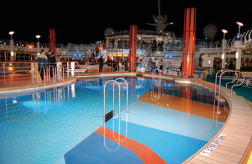 Freedom-of-the-Seas-night-pool - Meet new friends over poolside cocktails on your next Freedom of the Seas cruise.