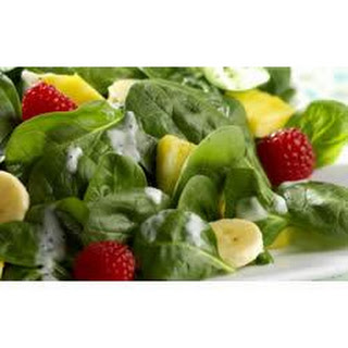 Fresh Fruit Salad with Baby Spinach and Yogurt-Poppy Seed Dressing.