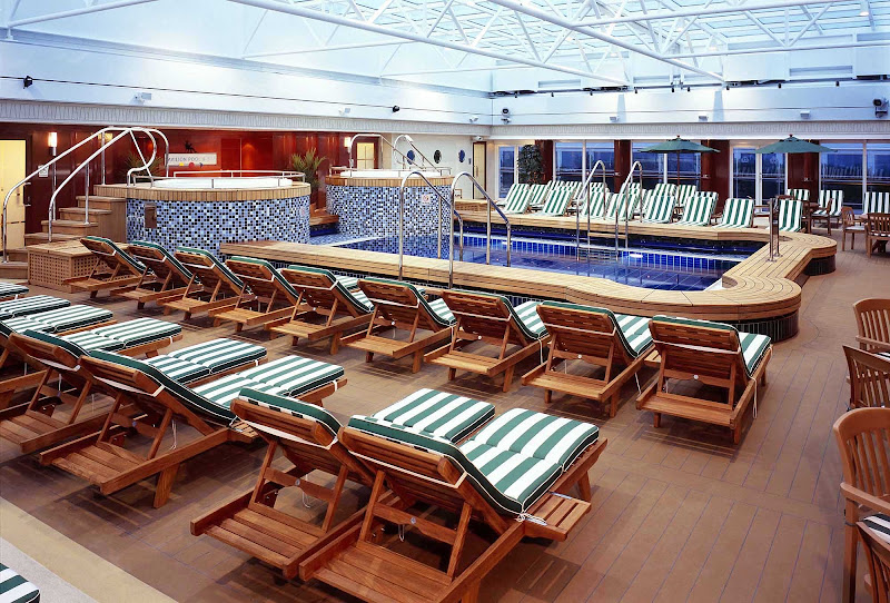 Take a dip in the Pavilion Pool with small waterfalls and a retractable roof aboard Queen Mary 2.