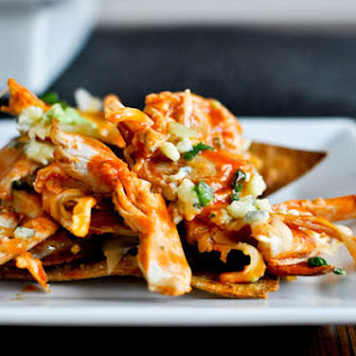 Baked Layered Buffalo Chicken Nachos.