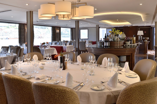 AmaVida-Restaurant - Meet interesting people and take in the sights during lunch and dinner in the main restaurant aboard AmaVida during your European river cruise.
