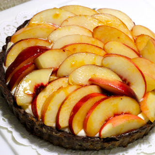 Mascarpone Mousse in Chocolate Tart decorated with Peaches marinated in Peach Liqueur.