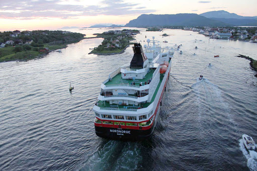 Hurtigruten-Nordnorge-in-Norway-5 - Hurtigruten's Nordnorge receives a caravan of well-wishers as she sails down the narrow peninsula into the village of Brønnøysund, Norway.