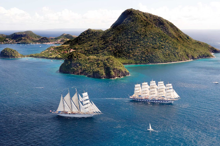 Royal Clipper leads the way for Star Clipper in exploring the Îles des Saintes near Guadeloupe in the Caribbean.