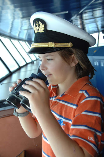 Junior-Cruisers-On-the-Bridge - A young cruiser visits the bridge and views the horizon on a Crystal cruise.