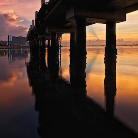 Under the Bridge by Christopher Harriot - Landscapes Waterscapes ( dawn, penang, reflections, sea, bridge, jetty, morning, sun )
