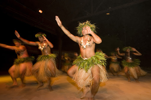 Evening entertainment on Moorea can include Tane dancers and traditional Mo'orean music.