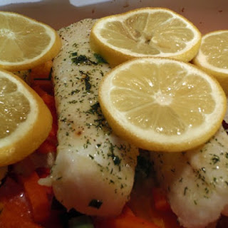 Veggie-Steamed Fish With Yogurt Dill Sauce.