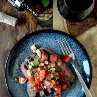 Red Wine Marinated Flank Steak with Cherry Tomato Caprese Salsa.