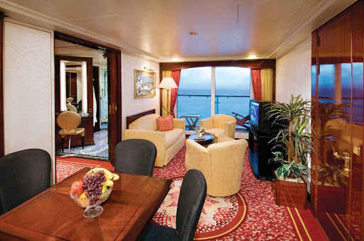 Comfortable bedroom furnishings and separate dining and living areas overlooking the  private balcony await you when you book a Penthouse with large balcony aboard Norwegian Spirit.