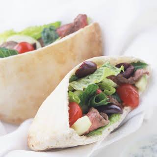 Lamb Souvlaki Sandwiches with Greek Salad and Tsatsiki Sauce.