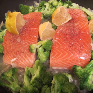 White Wine and Lemon-Steamed Salmon Cooked on Broccoli.