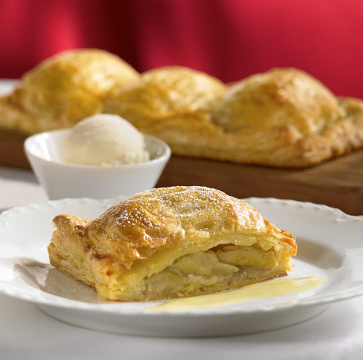 Royal-Caribbean-Main-Dining-Apple-Parcels - In Royal Caribbean cruises, a favorite desert is apple parcels, made with puff pasty, apples, cinnamon, sugar and almond paste, with a scoop of vanilla ice cream on the side.