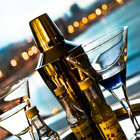 Ready for drinks by Sotiris  Filippou - Food & Drink Alcohol & Drinks ( reflection, glasses, shake, alcoholic, ocean, yellow, party, restaurant, drinks, shot, lights, sky, metal, nightclub, drink, glass, empty, pour, focus, gold, hangover, bottles, mixer, nightlife, clouds, water, orange, colors, silver, white, vodka, mix, shaker, liquid, beverage, blue, alcohol, club, scene, silver plate, night, stainless, bar )