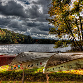 Cedar Lake Canoes by Ward Vogt - Landscapes Waterscapes ( clouds, water, autumn, foliage, fall, denville, cedar lake, nj, photography, canoes, new jersey, ward vogt )