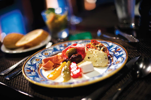 Norwegian-Cruise-Line-Moderno-Churrascaria-plate - Who can say no to a plate of Brazilian appetizers? You'll find it at Moderno Churrascaria aboard your Norwegian Cruise Line sailing.