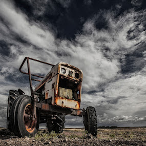 The Scream by Bragi Ingibergsson - Transportation Other ( clouds, old, iceland, sky, brin, bragi j. ingibergsson, landscape, tractor, abandoned )
