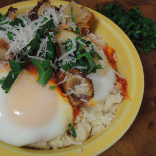 Eggs Poached in Tomato Sauce on Couscous with Oregano and Parsley