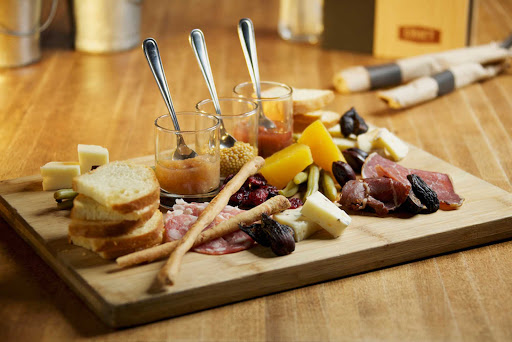 craft-beer-platter-Vancouver-British-Columbia - Locally cured meats from Two Rivers and assorted local cheese served with crostinis, preserves and mustard in Vancouver, British Columbia