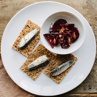 Sardines with Rye Crackers and Whole Grain Mustard Dressing.
