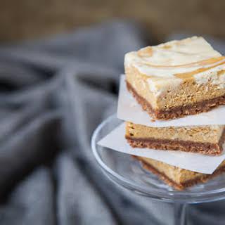Pumpkin Pie Cheesecake Bars with White Chocolate Vanilla Bean Swirl.