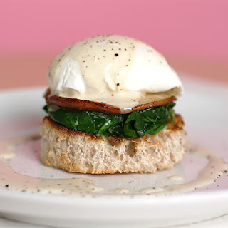 Poached Eggs With Shiitake Mushrooms, Wilted Arugula And White Truffle Cream.