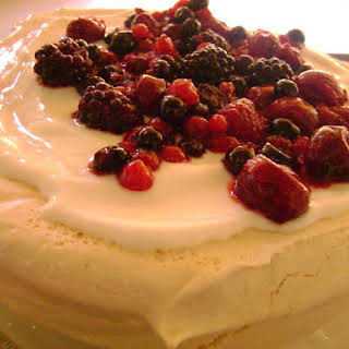 Pavlova with Greek Yogurt and Red Fruit Topping.