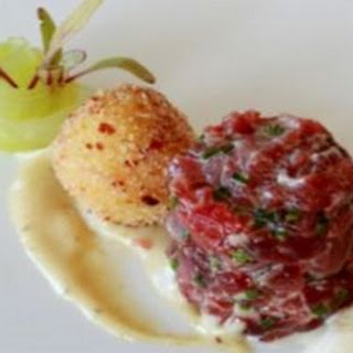 Free range beef tartar, quail egg and bacon fritter, Parmesan mousse