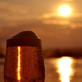Cooling beer by Matt Hulland - Food & Drink Alcohol & Drinks ( cool, water, beer, sunset, river )