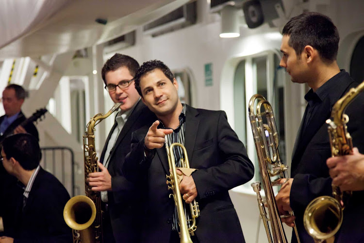 The cool cats in the Welcome Back Jazz Band entertain guests aboard an Azamara sailing to Bordeaux, France.
