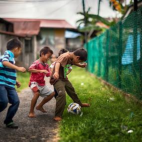 Street soccer by Siew Jun Han - Babies & Children Children Candids ( playing, football, children, bokeh, soccer )